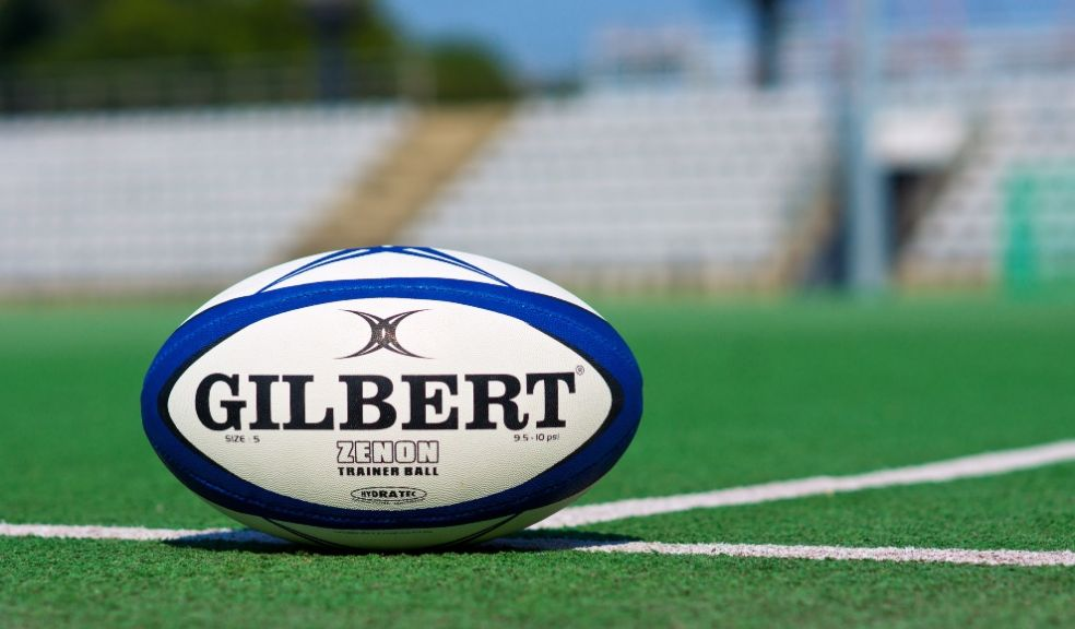 Rugby bal on pitch women's sport