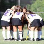 Field Hockey - team huddle