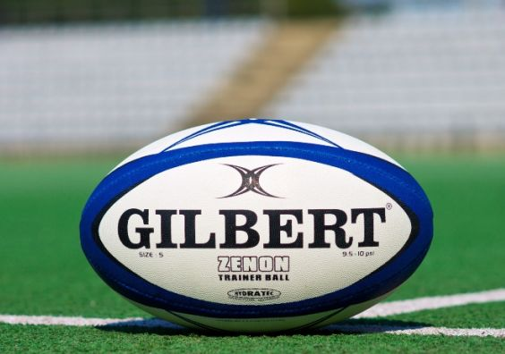 Rugby ball on pitch women's sport
