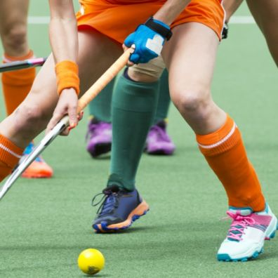 Women hockey players on the ball